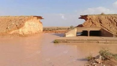 Photo of The floods break the road again between Nesma and Bani Walid